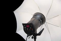 Photography studio strobe flash with white umbrella Stock Photos