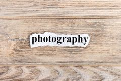 PHOTOGRAPHY text on paper. Word PHOTOGRAPHY on torn paper. Concept Image.  stock photography