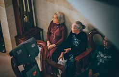 Photography of Three Old Women Sitting on Chair royalty free stock photo