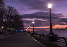 Photography of Turned on Street Lamps Beside Bay during Night Time Royalty Free Stock Photo