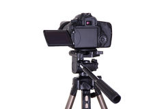 Photography and videography concept - modern dslr camera with bl. Ank screen on tripod isolated on white background Stock Photos