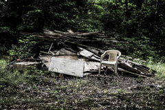 Photography of White Armchair Beside Wood Logs Royalty Free Stock Photography