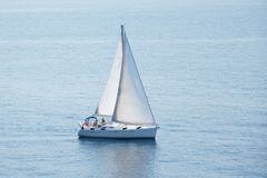 Sail boat in Sardinia`s sea. Photography of a white sail boat who navigate in Mediterraneo sea royalty free stock photos