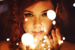 Photography of a Woman Holding Lights royalty free stock photography