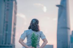 Photography of Woman Holding White Flowers Royalty Free Stock Photo