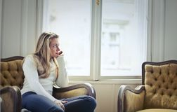 Photography of Woman Sitting on Chair Near Window Royalty Free Stock Photo