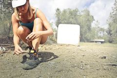 Photography of a Woman Tying Her Shoe Royalty Free Stock Photography