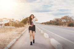 Photography of a Woman Walking on Pavement stock photos