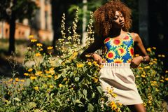 Photography of Woman Wearing Blue, Yellow and Red Floral Tank Top Standing Royalty Free Stock Image