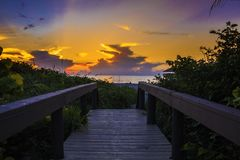 Photography of Wooden Bridge During Sunset Stock Images