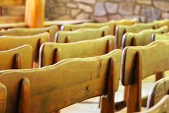 Photography Of Wooden Chairs In A Row royalty free stock photo
