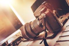 Photography Workstation. Digital Photography Workstation. Modern Digital DSLR Camera, Laptop Computer and Display