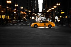 Photography of Yellow Taxi On Road stock photos