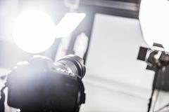 Photograpy studio with lighting equipment and a camera. Photograpy studio with ready lighting equipment. Focus on a camera stock photo