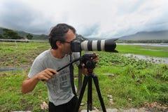 Photojournalist. LAKE BATUR, BALI - JANUARY 21. Photojournalist Ognjen Maravic documenting life on Lake Batur on January 21, 2012 in Bali, Indonesia. Changing Royalty Free Stock Photography
