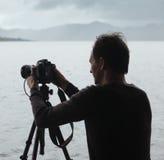 Photojournalist. Photographer taking photos on lake batur in Bali Royalty Free Stock Image