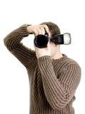 Photojournalist holding camera Stock Photography