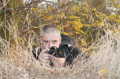 Photojournalist in a jungle. Royalty Free Stock Photography