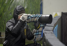 Photojournalist work in bad weather conditions Stock Image