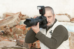 Photojournalist working. Royalty Free Stock Photo