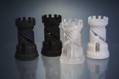 Photopolymer för fyra objekt som skrivs ut på en skrivare 3d royaltyfri foto