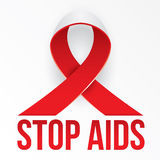 The photorealistic red ribbon is the global symbol for solidarity with HIV-positive people and those living with AIDS Royalty Free Stock Images