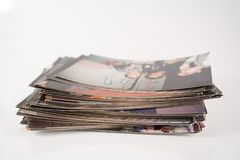 Photos. Stack of old photos isolated on white royalty free stock image