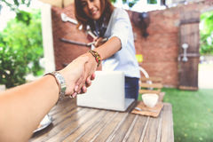Photos of Asian women who are shaking hands Stock Photos