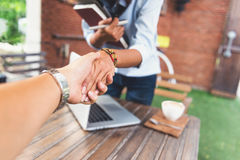 Photos of Asian women who are shaking hands Stock Images