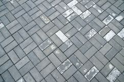 Photos of the background. Damp after a rain paving slabs. Wet the pavement Royalty Free Stock Images