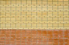 Photos of the background. A real, two-tone brick wall. With small errors in a laying. Royalty Free Stock Photography
