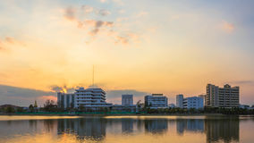 Photos Building River Town In Udon Thani, Thailand. Golden sky background. Sun during sunset Stock Images