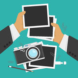 Photos and camera in flat style. Man holding a empty photo shot in hands. Vintage film camera and blank Photo frames  on green background. Photography concept Royalty Free Stock Image