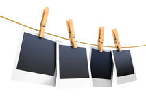 Photos on clothesline Stock Photography