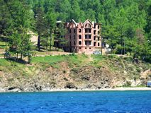 Photos contemporary architecture residential stone brick house on the shore of lake Baikal in Russia Stock Photos