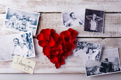 Photos of a couple in love. Red rose petal heart. Royalty Free Stock Photo