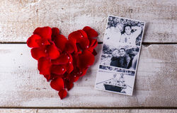 Photos of a couple in love. Red rose petal heart. Royalty Free Stock Photography