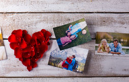 Photos of a couple in love. Red rose petal heart. Stock Photography