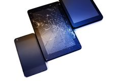 Photos of cracked display on a tablet and black cellphone isolated on white. Tablet with damaged screen.  royalty free stock photos