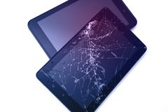 Photos of cracked display on a tablet isolated on white. Tablet with damaged screen. stock photo
