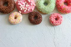 Photos of different donuts, free space for writing texts. Photos of different donuts. Assorted colorful donuts in glaze close-up, free space for writing textsn royalty free stock photography