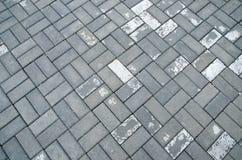 Photos du fond Humidité après les pavés d'une pluie Mouillez le trottoir images libres de droits