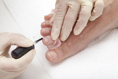 Photos of foot nail varnishing process, series of photos Royalty Free Stock Photography