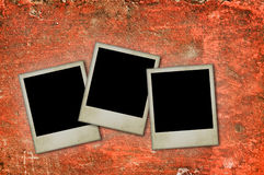 Photos frames. Old blank photos frames lying on a concrete wall surface for text and photo Stock Images