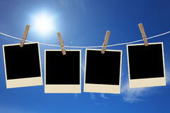 Photos frames hanging in the rope on a sky Stock Image
