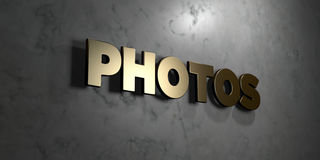 Photos - Gold sign mounted on glossy marble wall  - 3D rendered royalty free stock illustration Stock Photos