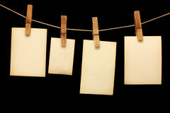 Photos hang on wood clothespin Royalty Free Stock Image