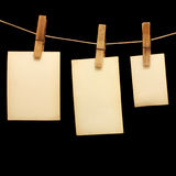 Photos hang on wood clothespin Royalty Free Stock Images