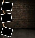 Photos hanging Stock Image