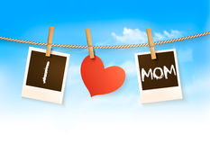 Photos hanging on a clothesline, spelling out I love mom. Stock Image